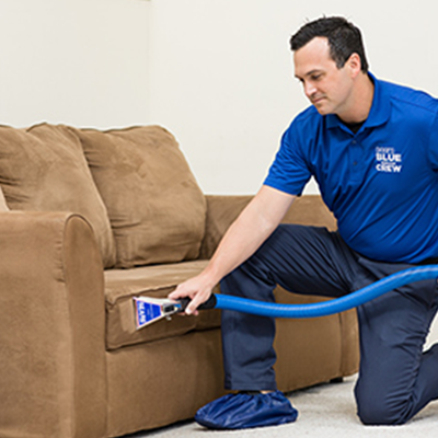 Sears Upholstery Cleaning Tech cleaning a couch